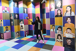November 1, 2018 - Hangzhou, China - Girl with a selfie stick takes a photo during the Asia Design Management Forum and Ideal Life Fair (ADM) 2018 in Hangzhou, east China' Zhejiang Province. (Credit Image: © SIPA Asia via ZUMA Wire)