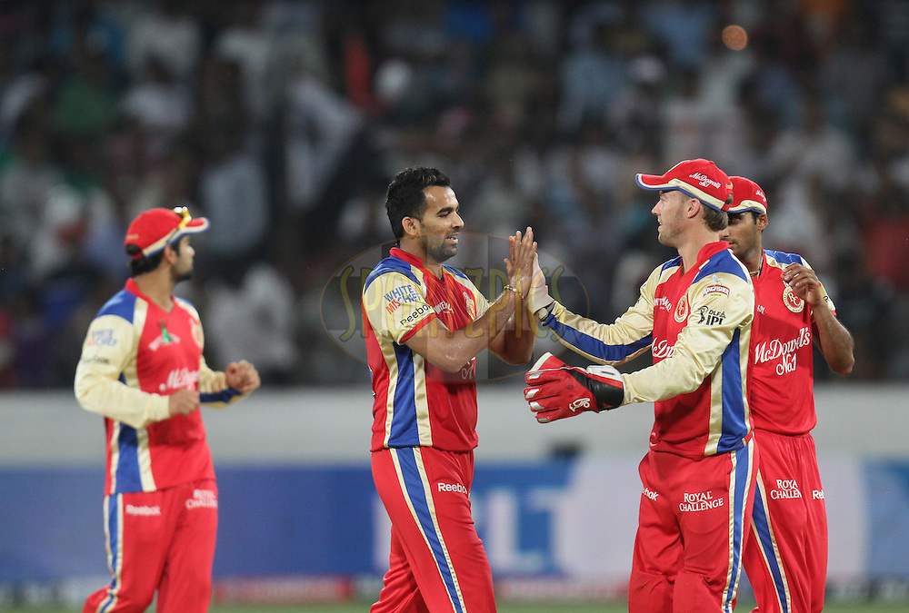Zaheer Khan (2nd L) of Royal Challengers Bangalore being congratulated by team members after taking the wicket of Daniel Christian of Deccan Chargers  during match 11 of the Indian Premier League ( IPL ) between the Deccan Chargers and the Royal Challengers Bangalore held at the Rajiv Gandhi International Cricket Stadium in Hyderabad on the 14th April 2011..Photo by Parth Sanyal/BCCI/SPORTZPICS
