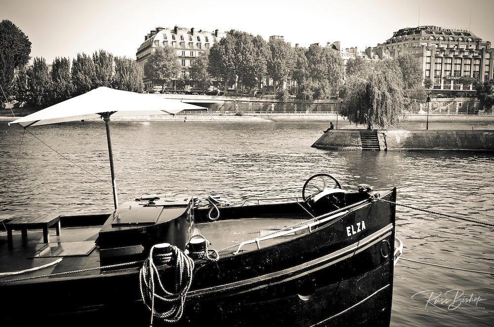 Boat docked along the Seine River, Paris, France