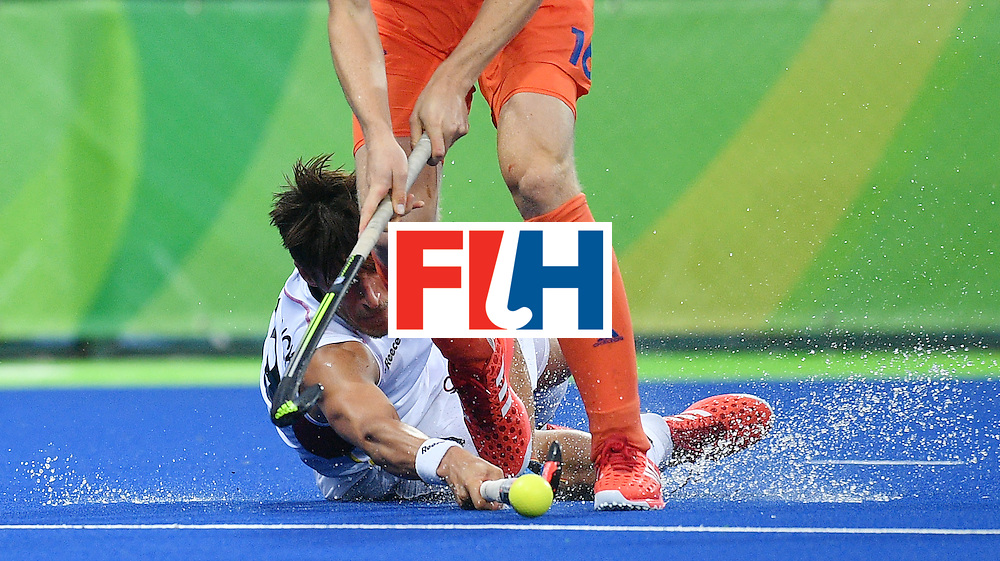 Belgium's Elliot van Strydonck (bottom) vies with Netherland's Mirco Pruijser during the men's semifinal field hockey Belgium vs Netherlands match of the Rio 2016 Olympics Games at the Olympic Hockey Centre in Rio de Janeiro on August 16, 2016.  / AFP / Carl DE SOUZA        (Photo credit should read CARL DE SOUZA/AFP/Getty Images)