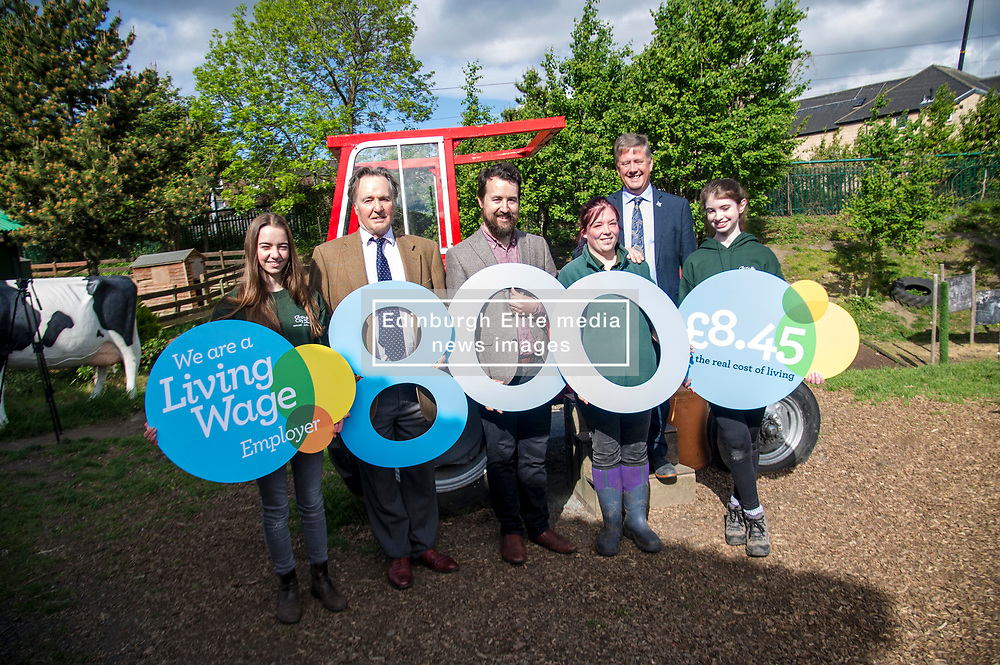 Pictured: Kirsty McGoff, Keith Brown, Maia Gordon, Josiah Lockhart, George Ellie and Zoe White<br /> <br /> Cabinet Secretary for Economy, Jobs & Fair Work Keith Brown visited Gorgie City Farm today  to mark their accreditation as the 800th Living Wage employer in Scotland. Mr Brown met Josiah Lockhart, CEO and undertook a short tour of the farm, celebrating their accreditation and promoting the Living Wage more generally. The Scottish Government has set a target of reaching 1,000 Scottish-based Living Wage Accredited Employers by autumn 2017. While at the farm Mr Brown met Maia Gordon, Kirsty McGoff (17) and Zoe White (18), who have benefited from the living wage, and George Ellis, chair of the farm's board of directors<br /> Ger Harley | EEm 18 May 2017