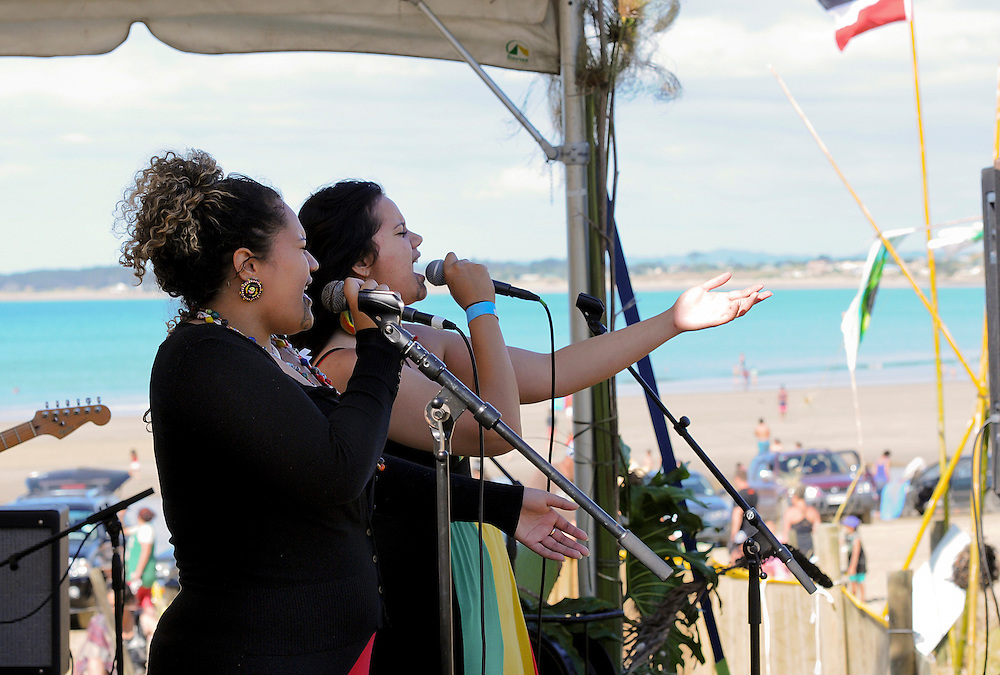 Singers from the band NRG Rising taking part in a concert at Shipwreck Bay, Ahipara, protesting at Norwegian firm Statoil's deep sea seismic testing off Northland's west coast, Northland, New Zealand, December 06, 2014. Credit:SNPA / Malcolm Pullman
