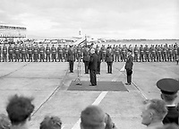 95149<br /> American President John Fitzgerald Kennedy (JFK)'s visit to Ireland, Éamon De Valera making speech, on the runway with crowds of people and Guard of Honour in view, at Dublin Airport, looked on by JFK, 26/06/1963 (Part of the Independent Newspapers Ireland/NLI Collection). (Box 1)