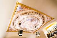NAPLES, ITALY - 4 JANUARY 2019: A reproduction of Vincenzo Lanfranco's affresco on the dome of the Saint Janarius' chapel is seen here at Janarius, a restaurant in Naples, Italy, on January 4th 2019.<br /> <br /> Janarius is a typical Neapolitan gourmet restaurant and shop founded by Francesco Andoli in September 2018 in via Duomo, in front of the Naples's Duomo and treasure of Saint Janarius.<br /> <br /> Saint Janarius is the patron saint of Naples.