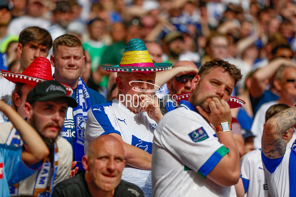 Nervous looking Tranmere Rovers football fans, football supporters, during the EFL Sky Bet League 2 Play Off Final match between Newport County and Tranmere Rovers at Wembley Stadium, London, England on 25 May 2019.