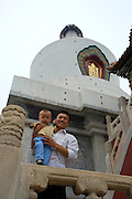 Baita Si (White Dagoba) on Qiongdao (Jade Island) in Beihai Lake. man with his baby son.