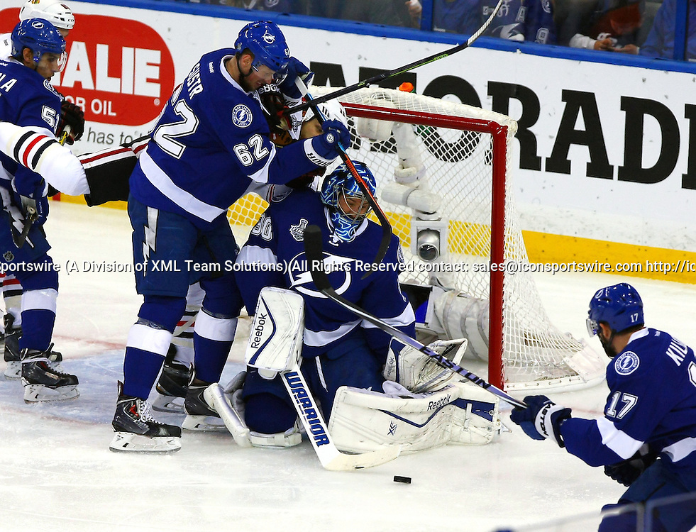 June 06 2015: Tampa Bay's Ben Bishop (30) makes a save in traffic in game two of the 2015 Stanley Cup Finals between the Chicago Blackhawks and the Tampa Bay Lightning at Amalie Arena in Tampa, Florida.