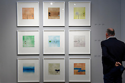 "© Licensed to London News Pictures. 03/05/2017. London, UK. A visitor views a collective set of prints called ""Images on the wall"", 1991-92, by Victor Pasmore a the preview of the 32nd London Original Print Fair at the Royal Academy of Arts in Piccadilly.  51 international specialist dealers are presenting works in the print medium to buyers from 4 May to 7 May. Photo credit : Stephen Chung/LNP"