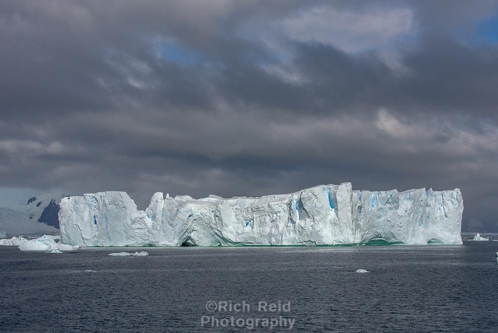 Iceberg with storm light in Antarctica.