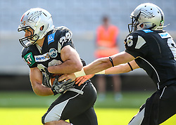 13.07.2013, Tivoli Stadion, Innsbruck, AUT, AFL Halbfinale, Swarco Raiders Tirol vs JCL Graz Giants, im Bild Andreas Hofbauer, (SWARCO Raiders Tirol, RB, #29) und Kyle Callahan, (SWARCO Raiders Tirol, QB, #6)  // during the Austrian Football League semifinal game between Swarco Raiders Tirol and JCL Graz Giants at the Tivoli Stadion, Innsbruck, Austria on 2013/07/13. EXPA Pictures © 2013, PhotoCredit: EXPA/ Thomas Haumer