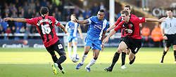 Peterborough United's Britt Assombalonga in action with Shrewsbury Town's Dave Winfield and Tamika Mkandawire - Photo mandatory by-line: Joe Dent/JMP - Tel: Mobile: 07966 386802 19/10/2013 - SPORT - FOOTBALL - London Road Stadium - Peterborough - Peterborough United V Shrewsbury Town - Sky Bet League One