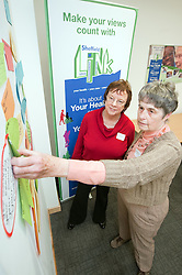 Sheffield Link member Sylvia Bennett adds her comment to the comments wall for Hilary Hull to act on during the Care Homes for Older People Action Group Launch Event at Sorby House Spital Hill Sheffield..4th November 2010.Images © Paul David Drabble