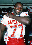 The American Football Conference Buffalo Bills defensive end Bruce Smith (77) poses for a photo in the locker room during photo day the week before the 1989 NFL Pro Bowl football game against the National Football Conference on Jan. 24, 1989 in Honolulu. The NFC won the game 34-3. (©Paul Anthony Spinelli)