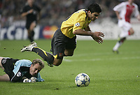 Jose Antonio Reyes is fouled in the box.<br />Photo: Barry Bland.<br />Ajax v Arsenal. UEFA Champions League.<br />27/09/2005.