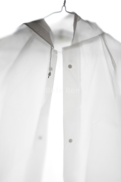 detail of a white translucent raincoat