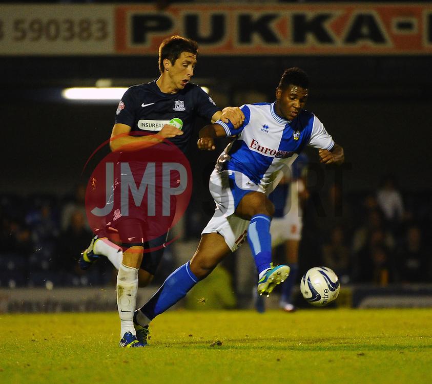 Bristol Rovers' Ellis Harrison battles with Southend United's Luke Prosser - Photo mandatory by-line: Seb Daly/JMP - Tel: Mobile: 07966 386802 27/09/2013 - SPORT - FOOTBALL - Roots Hall - Southend - Southend United V Bristol Rovers - Sky Bet League Two