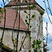 Château d'Annecy Tower in Annecy, France <br /> The magnificent tower of the Château d'Annecy was built onto the existing castle in 1445 by Louis I, a Count of Savoy. The fortified walls with battlements stand about 108 feet tall and are almost 40 feet wide. During the French Revolution, it became a prison. Today, it is part of Musée-Château.