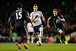 Erik Lamela of Tottenham Hotspur is challenged by Muhamed Besic of Everton - Photo mandatory by-line: Rogan Thomson/JMP - 07966 386802 - 30/11/2014 - SPORT - FOOTBALL - London, England - White Hart Lane - Tottenham Hotspur v Everton - Barclays Premier League.