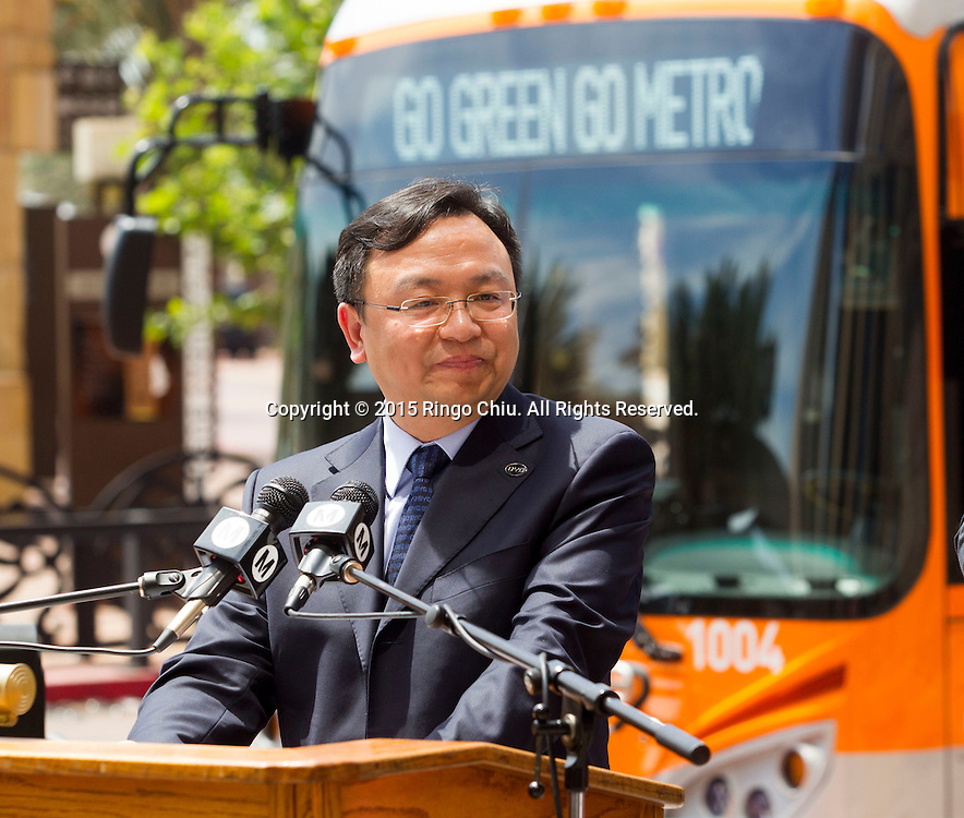 BYD Chairman Chuan Fu Wang, speaks in a news conference in front of Metro Headquarters on Thursday, April 30, 2015 in Los Angeles.  BYD, Ltd. has delivered five all-electric buses to the Los Angeles County Metropolitan Transportation Authority (Metro) for testing. These are the first of as many as 25 zero emissions buses being built for Metro in Lancaster, Calif. (Photo by Ringo Chiu/PHOTOFORMULA.com)