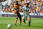 Middlesbrough defender George Friend (3) takes on Wolverhampton Wanderers striker Bright Enobakhare (26) 0-0 during the EFL Sky Bet Championship match between Wolverhampton Wanderers and Middlesbrough at Molineux, Wolverhampton, England on 5 August 2017. Photo by Alan Franklin.