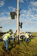 May 20 2013 Moore Oklahoma tornado damage and cleanup efforts. Electrical line crews work to repair downed powerlines. ©James Pratt / Alamy Live News