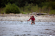 WA14439-00...WASHINGTON - Vicky Spring crossing the Queets River in Olympic National Park. (MR# S1)