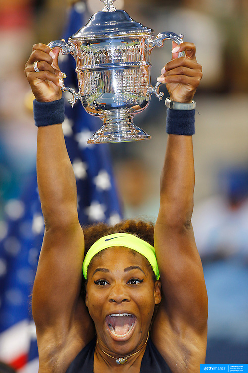 Serena Williams, USA, celebrates with the trophy after defeating Victoria Azarenka, Belarus, in the Women's SIngles Final during the US Open Tennis Tournament, Flushing, New York. USA. 9th September 2012. Photo Tim Clayton