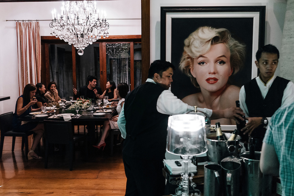 Guests have dinner in the dining room of a privately catered birthday party at a home in the wealthy neighborhood of Forbes Park in Makati, part of Metro Manila in the Philippines on March 1, 2016. Happy Ongpauco-Tiu, who runs the catering business, said these small bespoke catered parties are on the rise in Manila.