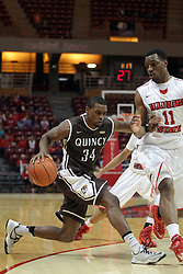 29 December 2014:  T.J. Riggs rushes past the 3 point line driving in on MiKyle McIntosh during an NCAA non-conference interdivisional exhibition game between the Quincy University Hawks and the Illinois State University Redbirds at Redbird Arena in Normal Illinois.