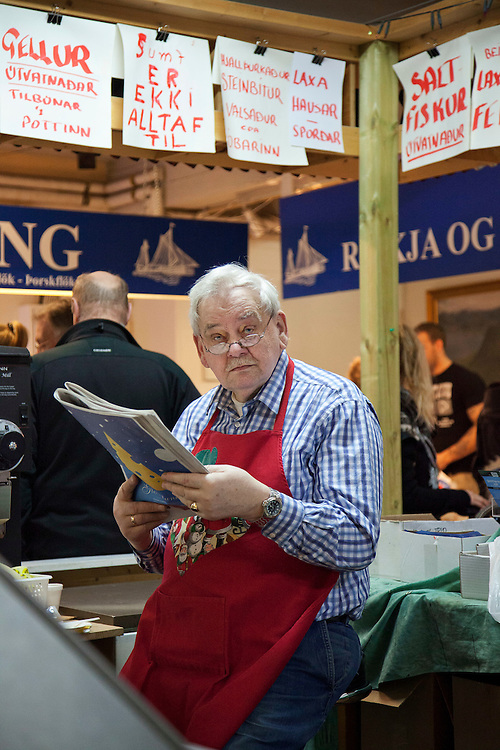 Meat vendor at the Kolaportið on December 21, 2013.