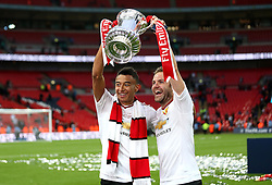 Manchester United goal scorers Jesse Lingard (L) and Juan Mata (R) of Manchester United celebrate winning the FA Cup with the trophy - Mandatory by-line: Robbie Stephenson/JMP - 21/05/2016 - FOOTBALL - Wembley Stadium - London, England - Crystal Palace v Manchester United - The Emirates FA Cup Final