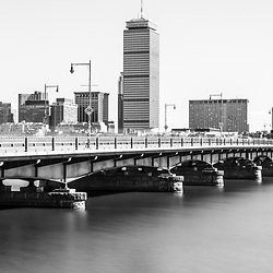 Harvard Bridge and Boston skyline black and white panorama photo. Includes Boston Back Bay, Charles River, John Hancock Tower, and Prudential Tower. Boston Massachusetts is a major city in the Eastern United States of America. Panorama photo ratio is 1:3.