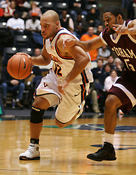 A determined Billy Campbell (12) takes the ball up court against Fordham. The Wahoos lost to the Rams 62-60...The Virginia Cavaliers fell to the Fordham Rams 62-60 at University Hall in Charlottesville, VA on December 7, 2005.