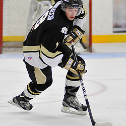 COBOURG, ON - Oct 19: Ontario Junior Hockey League game between Kingston Voyageurs and Trenton Golden Hawks. Mathew Andreacchi #18 of the Trenton Golden Hawks Hockey Club skates with the puck during first period game action..(Photo by Shawn Muir / OJHL Images)