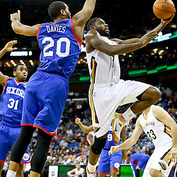 Nov 16, 2013; New Orleans, LA, USA; New Orleans Pelicans point guard Tyreke Evans (1) shoots over Philadelphia 76ers power forward Brandon Davies (20) during the second half of a game at New Orleans Arena. The Pelicans defeated the 76ers 135-98. Mandatory Credit: Derick E. Hingle-USA TODAY Sports