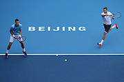 11.10.2015. Beijing, China.  Vasek Pospisil (L)of Canada and Jack Sock of the United States compete during the mens  doubles final against Danel Nestor of Canada and Edouard Roger-Vasselin of France at 2015 China Open Tennis Tournament in Beijing, capital of China, Oct. 11, 2015. Pospisil and Sock won 2-1 to claim the title.
