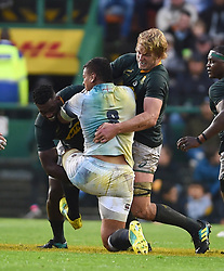 Cape Town-180623-Nathan Hughes of England  tackled by Siya Kolisi and Pieter Steph du Toit  of South Africa of England  in the last game of the Castle Lager Test between Springboks and England at Newlands Stadium photographer:Phando Jikelo/African News Agency/ANA