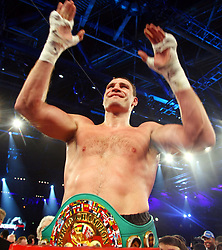 Ukrainian boxer Vitali Klitschko celebrates after he defeats challenger Juan Carlos Gomez of Cuba in their WBC heavyweight title fight on March 21, 2009 at the Hanns-Martin-Schleyer-Halle in Stuttgart, southern Germany.