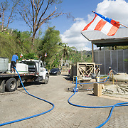 OCTOBER 25 - UTUADO, PUERTO RICO - <br /> Residents drive up to a  station next to the Lago Dos Bocas in Utuado to collect potable water. Troops from Fort Bragg, NC, are using a water filtration system to purify the liquid.<br /> (Photo by Angel Valentin/Freelance)