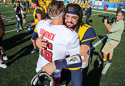 Oct 14, 2017; Morgantown, WV, USA; West Virginia Mountaineers quarterback Will Grier (7) talks with Texas Tech Red Raiders quarterback Nic Shimonek (16) after the game at Milan Puskar Stadium. Mandatory Credit: Ben Queen-USA TODAY Sports