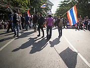 30 NOVEMBER 2013 - BANGKOK, THAILAND:  Anti-government students from Ramkhamhaeng University in Bangkok walk back to a road block to stop pro-government Red Shirts from entering their campus Satuday. Political faultlines in Bangkok, the Thai capital, hardened Saturday. Antigovernment factions repeated promises to strike at the heart of Bangkok Sunday and bring down the government while thousands of Red Shirts, who support the government, have come to Bangkok from their base in rural Thailand to defend the government. Prime Minister Yingluck Shinawatra has appealed for calm, but her opponents have rejected all requests for negotiations saying the only acceptable outcome is the eradication of the government.       PHOTO BY JACK KURTZ