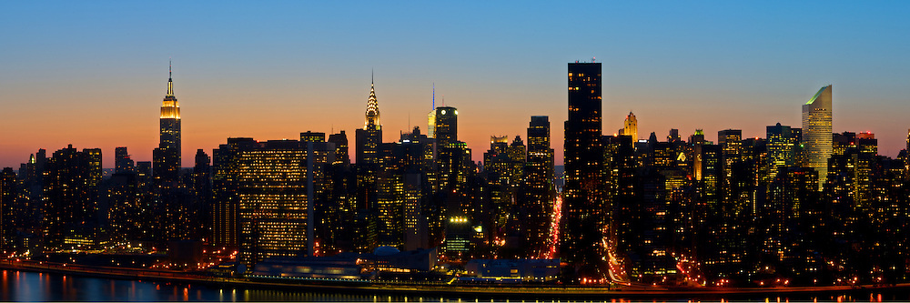 Sunset over New York City with many of the iconic buildings visible.  The Empire State Building, Chrysler Building, the Secretariat (United Nations), Bank of America Tower, The Citi Building.  New York City, NY.
