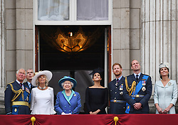 """File photo dated 10/07/18 of (left to right) Prince of Wales, Duke of York (obscured), the Duchess of Cornwall, Queen Elizabeth II, the Duke and Duchess of Sussex, Duke and Duchess of Cambridge, on the balcony at Buckingham, Palace watching a Royal Air Force flypast over central London to mark the centenary of the Royal Air Force. The Duke and Duchess of Sussex have announced they are to """"step back"""" as senior members of the royal family and will now divide their time between the UK and North America."""