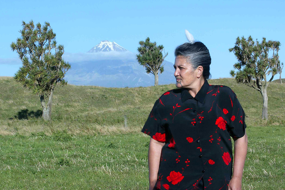 Taranaki Tribe Kuia Mahinekura Reinfeld displaying the white feather of Te Whiti , a sign of peace, near her home Marae at Parihaka in West Taranaki with Mt Taranaki in the background. Credit:SNPA / Rob Tucker