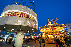 Traditional Christmas Market at Alexanderplatz in Mitte, Berlin, Germany. Pictured World clock and double height carousel