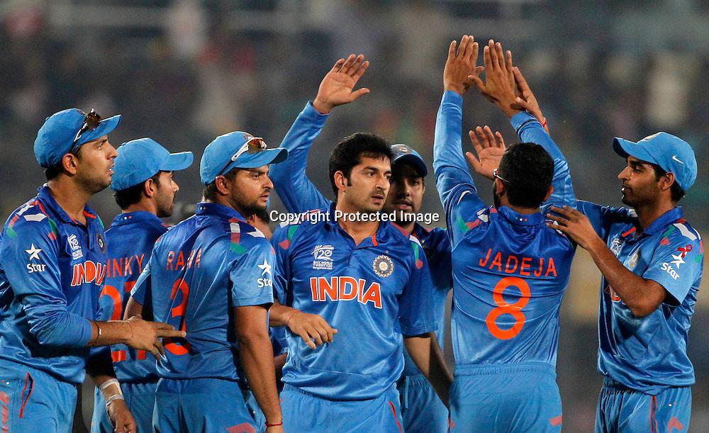 India celebrate a wicket, ICC T20 cricket World Cup Final - Sri Lanka v India, Sher-e-Bangla National Cricket Stadium, Mirpur, Bangladesh, 6 April 2014. Photo: www.photosport.co.nz