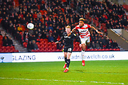 Mallik Wilks of Doncaster Rovers (7) heads on goal above Ben Williams of Barnsley (28) during the EFL Sky Bet League 1 match between Doncaster Rovers and Barnsley at the Keepmoat Stadium, Doncaster, England on 15 March 2019.