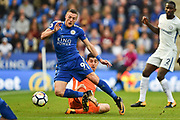 Chelsea goalkeeper Thibaut Courtois (13) brings down Leicester City forward Jamie Vardy (9) giving the Foxes a penalty during the Premier League match between Leicester City and Chelsea at the King Power Stadium, Leicester, England on 9 September 2017. Photo by Jon Hobley.