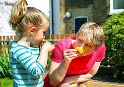 © Licensed to London News Pictures. 15/04/2015. LONDON, UK. Labour Party's Shadow Home Secretary Yvette Cooper playing with children at Stockwell Gardens Nursery in south London to launch Labour's Women's Manifesto on Wednesday, 15 April 2015. Photo credit : Tolga Akmen/LNP
