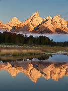 Middle and Grand Teton and Teewinot reflect in the Snake River at Schwabacher Landing, Grand Teton National Park, Wyoming, USA